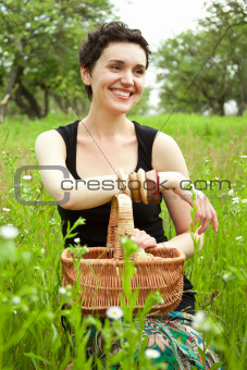 woman with basket in the garden