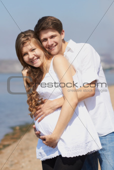 Happy pregnant girl and her loving husband