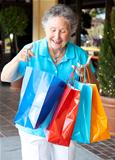 Senior Shopper Inspects Bags