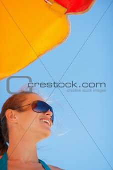 Portrait of happy woman on windy beach