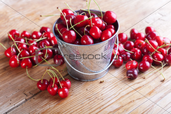 Cherries on wooden board