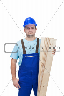 Worker in uniform holding wooden planks