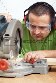 Carpenter worker cutting wood
