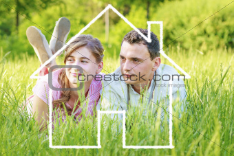 Young couple dreaming to a house