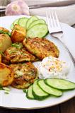 Zucchini Fritters and slices of new potatoes.