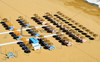 beach with sunlounger and umbrellas