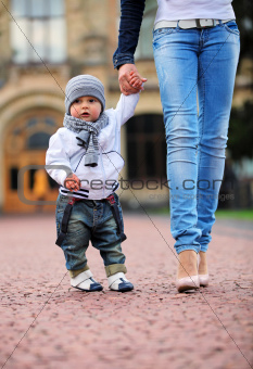 Toddler holding mother's hand
