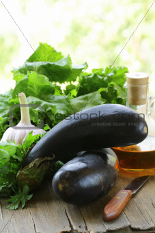 fresh ripe organic eggplants on a wooden table