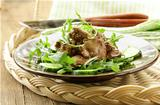 delicious salad with arugula and chicken liver