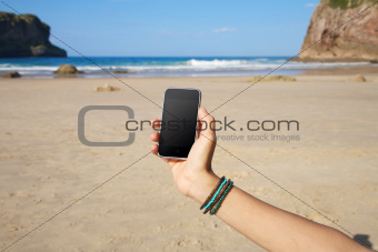 blank smartphone in the beach