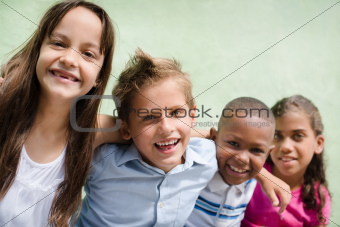 happy children hugging, smiling and having fun
