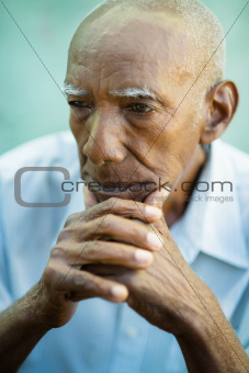 Portrait of sad bald senior man