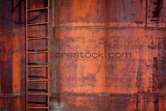 Rusty metal background with a ladder