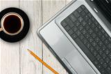 laptop and coffee cup on wooden table