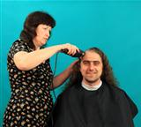 Man having an haircut on the green background