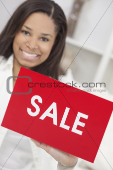 African American Woman Holding Sale Sign
