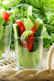 appetizer salad of fresh vegetables in a glass