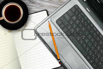 workplace with laptop, notebook and coffee cup