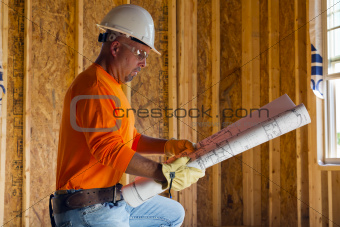 Male Construction Worker Reading Blueprints