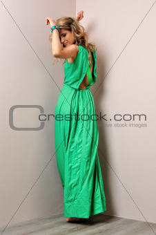 Portrait of the beautiful woman in a long green dress.