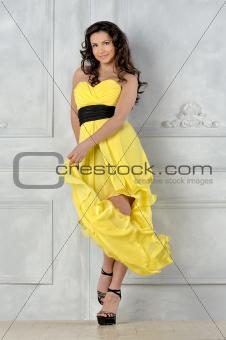beautiful woman in yellow evening dress.