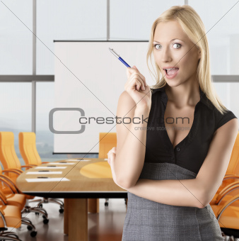 blonde business woman tkes pen