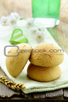 three round biscuits on a wooden table