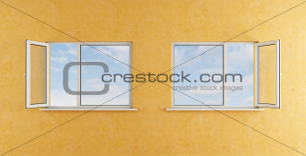 yellow room with two open windows