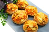 Mushrooms stuffed with vegetables and chicken.