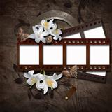Vintage background with photo-frame and film strip
