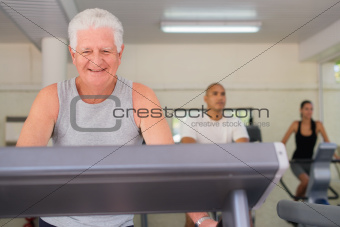 senior man exercising in wellness club