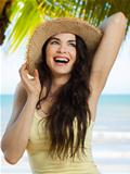 Happy young woman on tropical beach
