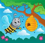 Cartoon bee with hive