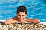 smiling boy in the swimming pool