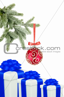 Christmas ball on the tree and gift boxes on white background