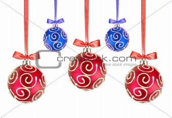 Red and Blue Christmas balls with bows on white background