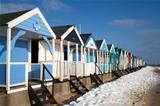 Beach Huts in the snow at Southwold, Suffolk, England
