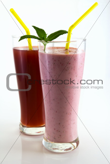 strawberry cocktail and juice with mint leaves and straw