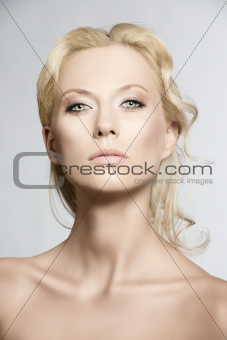Portrait of pretty blonde woman, she is in front of the camera