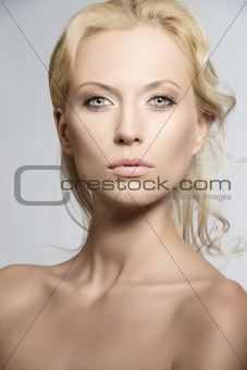 Portrait of pretty blonde woman with sensual expression