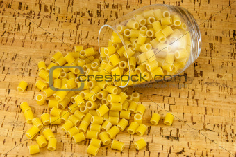 Ditalini pasta inside transparent glass