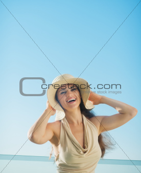 Portrait of happy woman on sea background