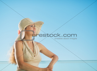 Portrait of happy woman standing on balcony