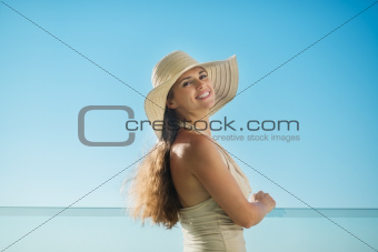 Portrait of dreaming woman standing on balcony and looking on copy space