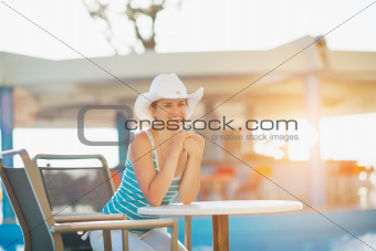 Woman sitting at pool bar