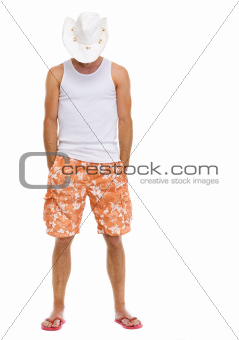 Full length portrait of on vacation man in shorts and holiday hat