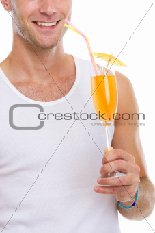 Closeup on happy man holding cocktail