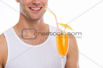 Closeup on happy guy holding cocktail