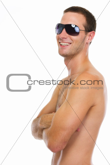 Portrait of smiling young guy in sunglasses