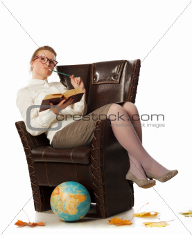 female teacher sitting in armchair